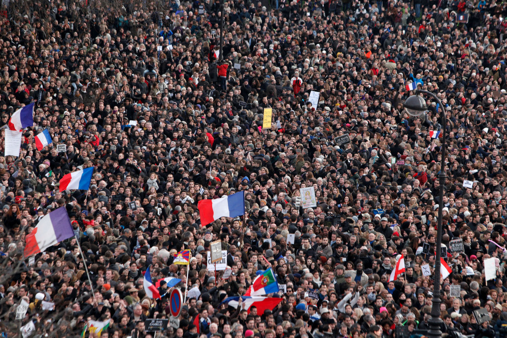 Thousands of people gather at Place de la Nation during a rally in Paris, Sunday, Jan. 11, 2015. Hundreds of thousands gathered Sunday throughout Paris and cities around the world, to show unity and defiance in the face of terrorism that killed 17 people in France's bleakest moment in half a century. (AP Photo/Thibault Camus)