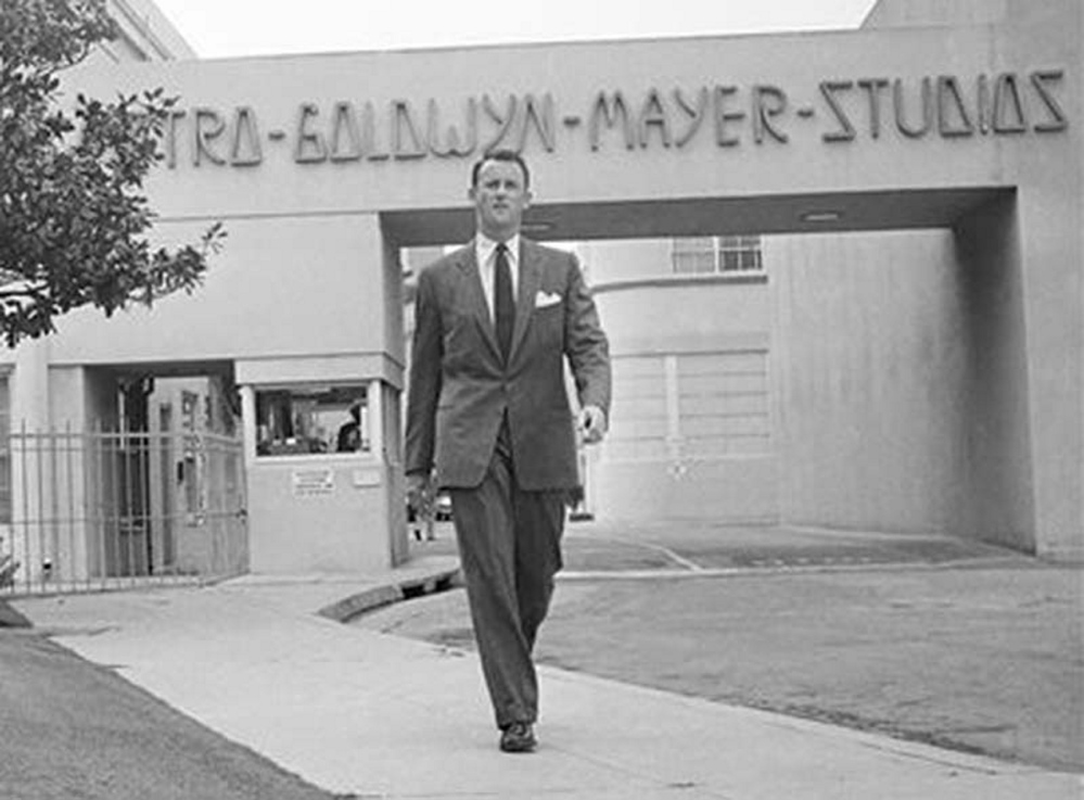 In this April 22, 1959, photo, Samuel Goldwyn, Jr., poses outside the main gate at Metro-Goldwyn-Mayer studios in the Hollywood section of Los Angeles. Goldwyn Jr., a champion of the independent film movement and son to one of the founding fathers of Hollywood cinema, died Friday from congestive heart failure, his son told the Los Angeles Times. He was 88.