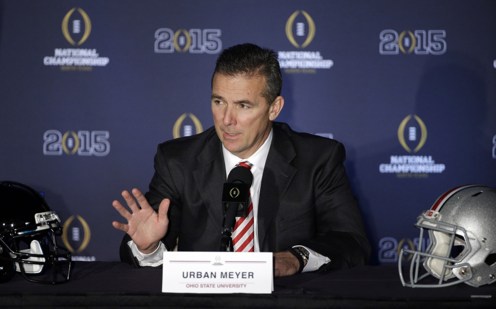 Ohio State Coach Urban Meyer speaks during a news conference before the NCAA college football playoff championship game on Sunday. Oregon plays Ohio State in the championship game on Monday.