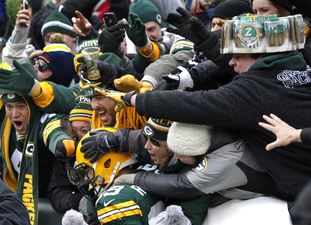 Green Bay Packers tight end Richard Rodgers (89) celebrates a touchdown with fans during the second half of an NFL divisional playoff football game against the Dallas Cowboys Sunday in Green Bay, Wis.