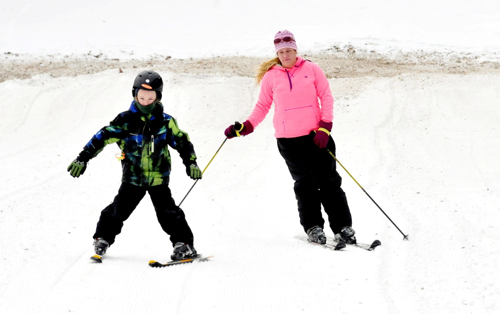 On Sunday, Bradie Castonguay of Waterville and her son, Ethan, ski down a trail at Eaton Mountain Ski and Snowtubing resort in Skowhegan on the second day in nearly a decade that skiing has been available.
