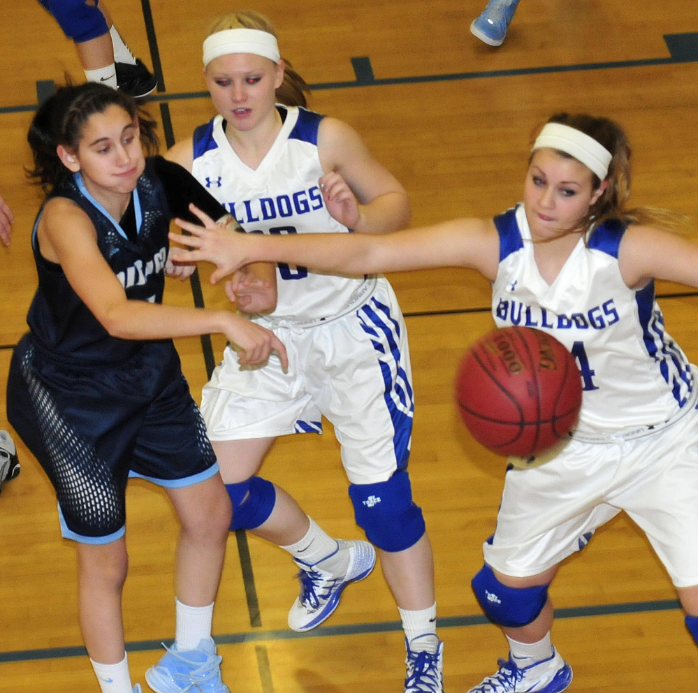 Madison's Erin Whalen, right, and Dirigo's Emma Lueders battle for ball during game Monday in Madison. Madeline Wood is at center. Dirigo won 55-47.