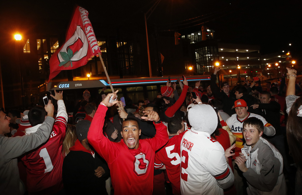 Ohio State students celebrate, early Tuesday, at the Student Union on High Street in Columbus, Ohio, following their team's win in the NCAA National Championship football game against Oregon.