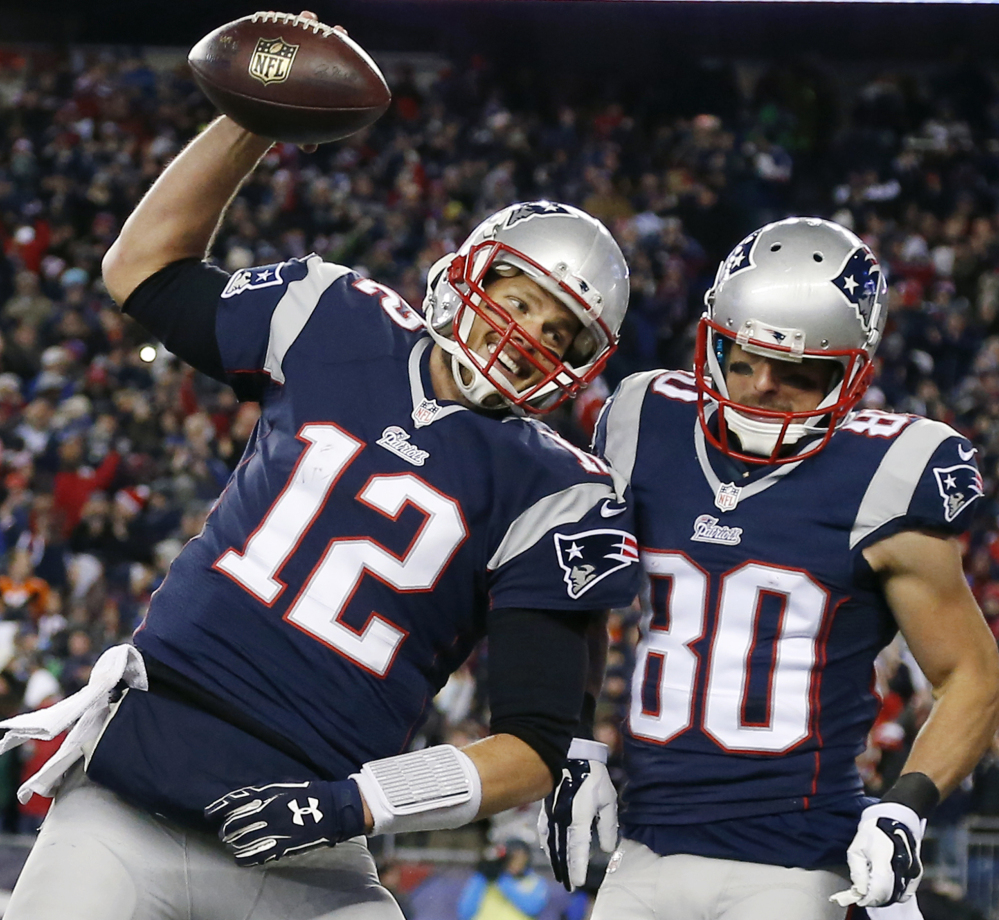New England Patriots quarterback Tom Brady celebrates with wide receiver Danny Amendola in the first half of a recent game in Foxborough, Mass. All four teams in this weekend's conference championships navigated a winding road.