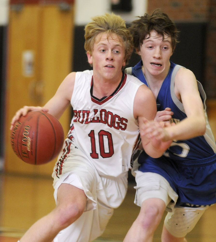 Hall-Dale High School's Nat Crocker, left, maneuvers around Mountain Valley High School's Alex Ridley during a Mountain Valley Conference game Tuesday night.