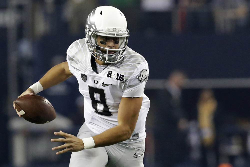 The Associated PRess In this Monday photo, Oregon's Marcus Mariota (8) runs against Ohio State during the first half of the NCAA college football playoff championship game in Arlington, Texas.