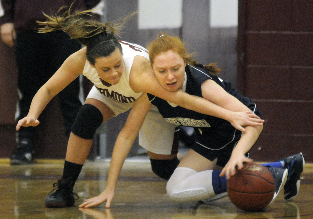Richmond High School's Camryn Hurley, left, attempts to block Pine Tree Academy's Angel Hood during a Wednesday's game in Richmond.