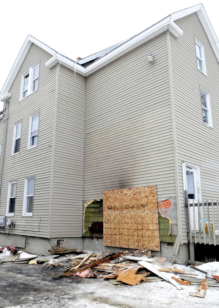 Damage from fire can be seen in the rear section of an apartment building at 28 Bellevue Street in Winslow on Thursday.