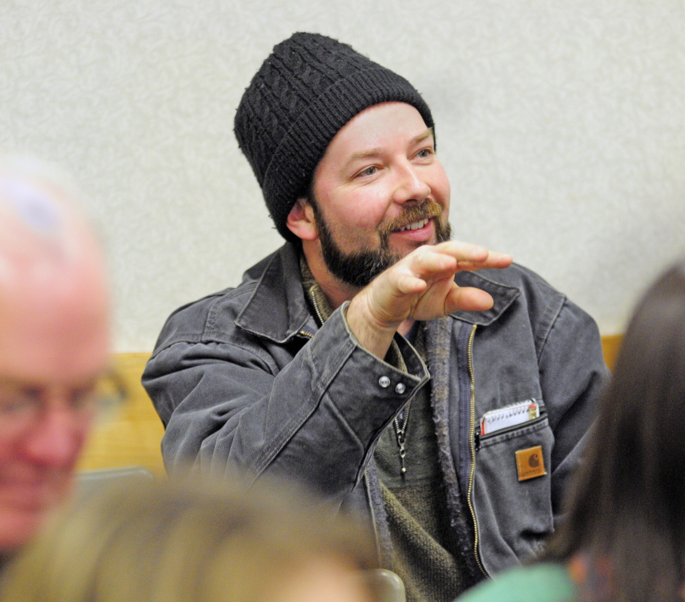 Matt Carter, associate farm manager at Pietree Orchard in the town of Sweden, asks a question during a lecture on social media marketing Thursday during the 74th Annual Agricultural Trades Show at the Augusta Civic Center.