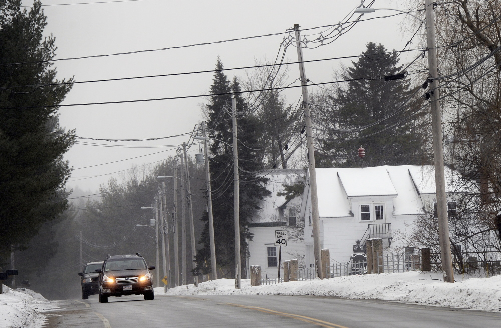 Vehicles make their way down Pequawket Trail on Thursday in West Baldwin near the West Baldwin Fire Department.