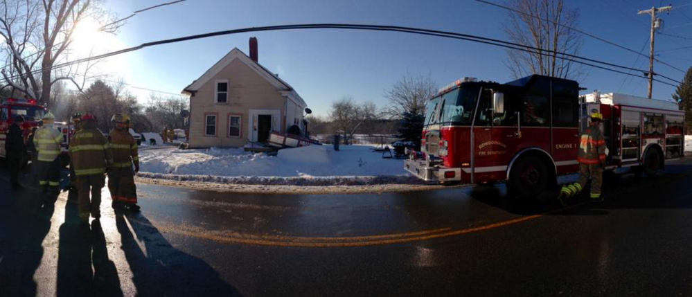 Firefighters from Richmond and other surrounding towns clean up after a house fire at 246 Main St.