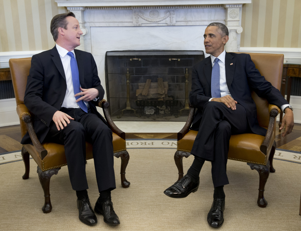 The Associated Press President Barack Obama meets with British Prime Minister David Cameron on Friday in the Oval Office of the White House in Washington.