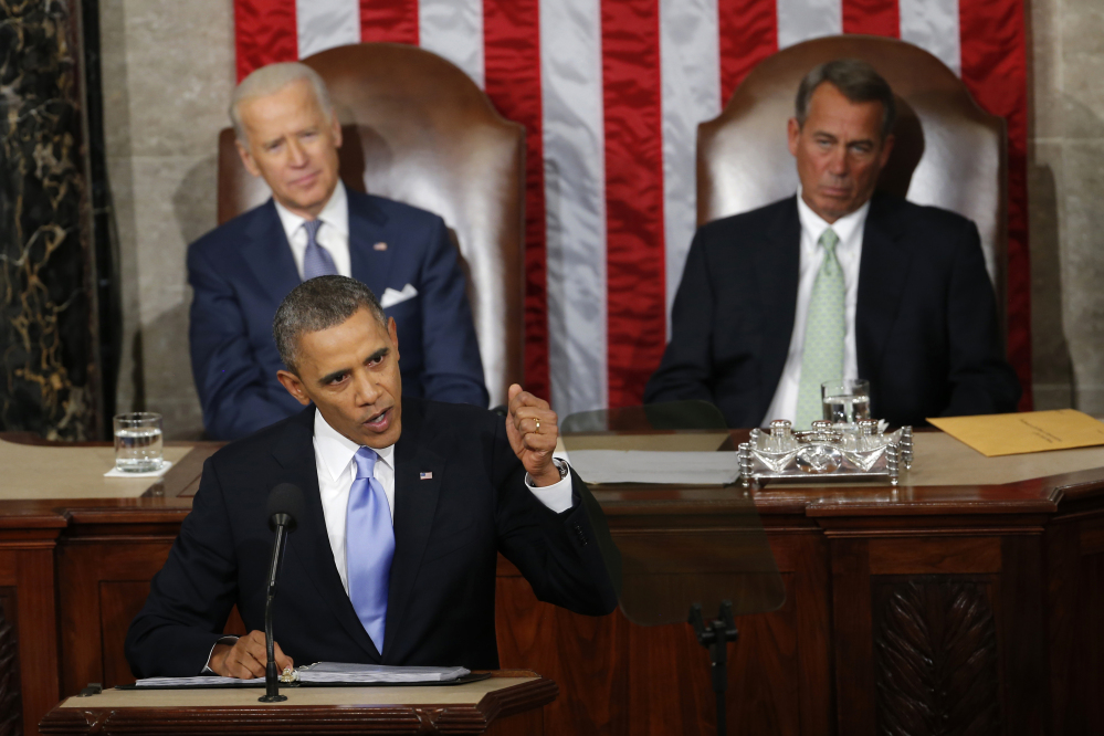 In this Jan. 28, 2014 photo, Vice President Joe Biden and House Speaker John Boehner of Ohio listens as President Barack Obama gives his State of the Union address on Capitol Hill in Washington. For the first time in his presidency, Obama stands before a Republican dominated Congress angry over his growing list of veto threats and opposed to the agenda he presents to them.