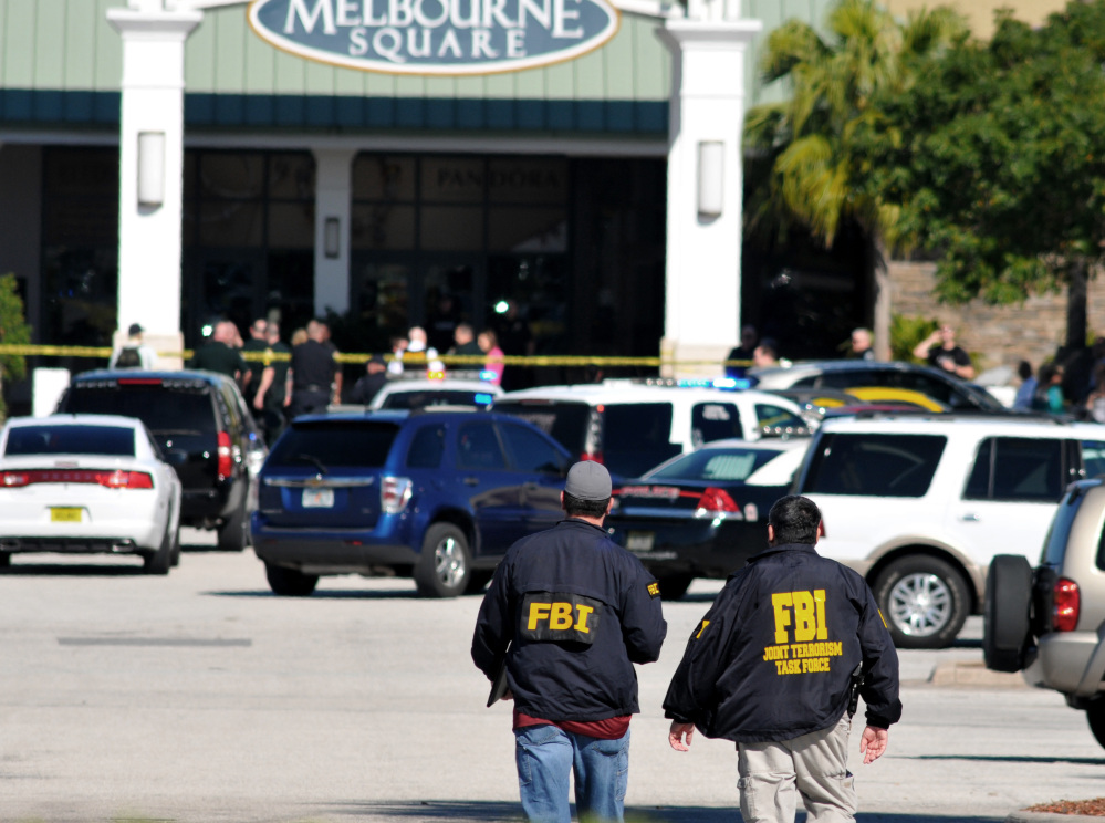 Law enforcement including the FBI respond to the scene of a shooting at the Melbourne Square Mall on Saturday in Melbourne, Fla. Melbourne Police have confirmed that the shooting Saturday morning at the mall has left two people dead and one injured from a gunshot wound.