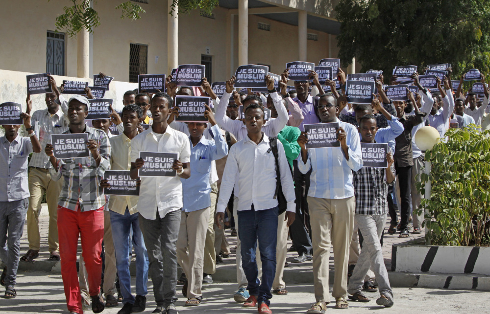 """Somali University students carrying placards in French reading """"I am Muslim, and I love my Prophet"""" march through the capital to protest depictions of the Prophet Muhammad in the French magazine Charlie Hebdo, in Mogadishu, Somalia on Saturday. Supporters say the cartoon on the cover of Charlie Hebdo is a defiant expression of free speech following a terrorist attack on the publication's Paris offices that killed 12 people on Jan. 7, but many Muslims viewed it as another attack on their religion."""