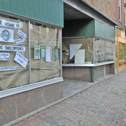 Renovation proceeds Tuesday behind the paper-covered windows in the space that will become the Gardiner Food Co-op & Cafe on Water Street in downtown Gardiner.