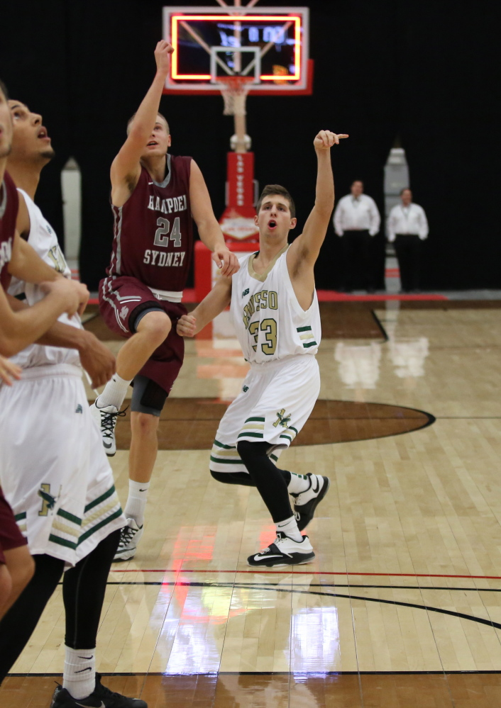 Husson University freshman Jordan Holmes, right, follows through on a shot at the buzzer in a game against Hampden-Sydney College on Dec. 29 in the D3hoops.com Classic at South Point Arena in Las Vegas. A graduate of Messalonskee High School, Holmes got his first collegiate start Jan. 10 in a 78-64 win over Maine Maritime.