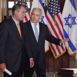 In this May 24, 2011 file photo, Israeli Prime Minister Benjamin Netanyahu walks with House Speaker  John Boehner of Ohio to make a statement on Capitol Hill in Washington. Boehner has invited Netanyahu to address Congress about Iran.