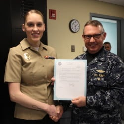 MA Seaman Whitney Scott, left, with  Commanding Officer of Naval Station Newsport, Captain Dennis Boyer.