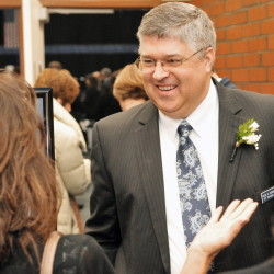Ross Cunningham, the new Kennebec Valley Chamber of Commerce new president and CEO, greets people entering the annual awards banquet at the Augusta Civic Center.