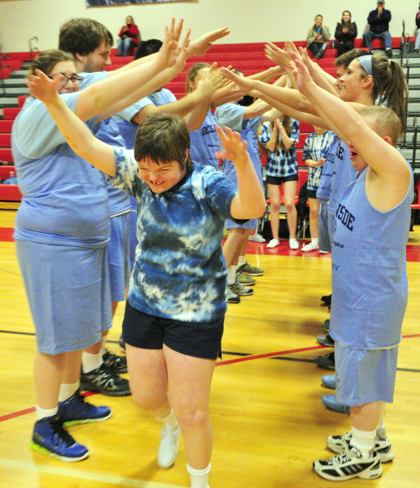 Oceanside Unified spirit squad member Emma Arndt is introduced before a unified basketball game Friday at Cony High School in Augusta. It was the state's first ever unified game