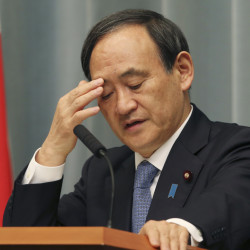 "Japan's Government spokesman Chief Cabinet Secretary Yoshihide Suga ponders during a press conference at the prime minister's official residence in Tokyo on Friday as militants affiliated with the Islamic State group have posted an online warning that the ""countdown has begun"" for the group to kill the pair of Japanese hostages."