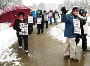 Strikers face heavy snowfall as they observe the 100th day of striking against FairPoint for a fair contract.