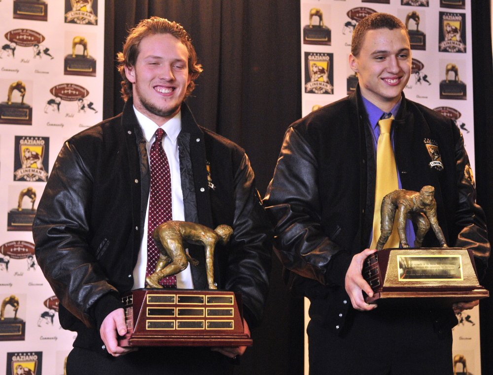Frank J. Gaziano winners Zach Davis, left, of Windham and Zordan Holman, of Cheverus, pose with trophies at the award ceremony Saturday at the Augusta Civic Center. Davis was named the top offensive lineman while Holman was named the top defensive lineman.