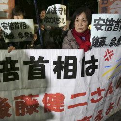 "Anti-Prime Minister Shinzo Abe protesters rally with signs and a banner reading: ""Prime Minister Abe, save the life of Kenji Goto!"" in front of Abe's official residence in Tokyo Sunday."