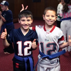 Gaige Martin and Michael Stewart, students at Huard's Martial Arts Dojo in Winslow, participated Wednesday in a New England Patriots AFC Championships' rally during class.