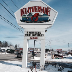 A sign on Kennedy Memorial Drive in Waterville advertises a dinner special at the Weathervane restaurant on Monday. The chain closed restaurants in Waterville, Brewer and South Portland on Monday, citing economic conditions.