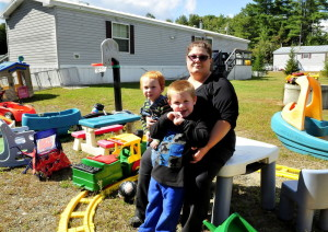 Dawn Zammuto with her grandchildren Allen, left, and Dominic in a September photograph taken outside the home she rented in Norridgewock. The state Human Rights Commission has ruled that her landlords illegally discriminated against her when they attempted to evict her after her daughter visited with a service dog.