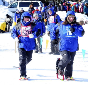 Jamie Buck, left, and Sharrie Zlotnick of Work First in Farmington compete in snowshoe events during the Special Olympics Maine Winter Games at Sugarloaf on Monday.