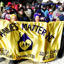 Athletes with Families Matter take part in the opening ceremony parade during the Special Olympics Maine Winter Games held at Sugarloaf on Monday.