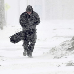 """Alan Brickett struggles to walk in the blowing snow in Waterville during the snow storm on Tuesday. """"This weather is very intense out here,"""" Brickett said."""