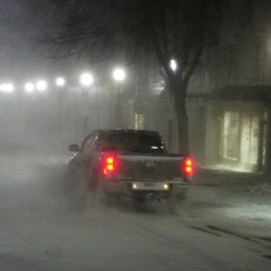 Snow drifts over the road as pickup heads down Water Street during a winter storm  around 6:10 a.m. on Tuesday in downtown Gardiner.