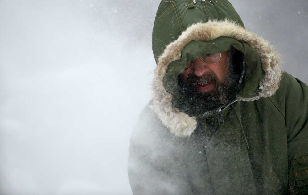 Steve Libby clears a fire hydrant with his snowblower on West Street in Waterville on Tuesday.