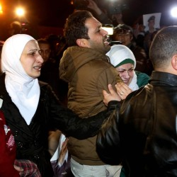 A man comforts the wife, right, of a Jordanian pilot, Lt. Muath al-Kaseasbeh, who is held by the Islamic State group militants, during a protest in front of the Royal Palace in Amman, Jordan, on Wednesday.