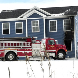 Firefighters from several departments extinguished a fire at a home on Mudget Hill Road in Vassalboro on Wednesday morning. Staff photo by David Leaming