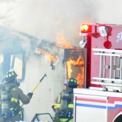 Firefighters pull back walls to expose fire as the work to extinguish a barn at 845 Northern Avenue on Wednesday January 28, 2015 in Farmingdale. The fire was reported just before noon Wednesday and it was mostly out by 12:30 p.m. No injuries were reported.