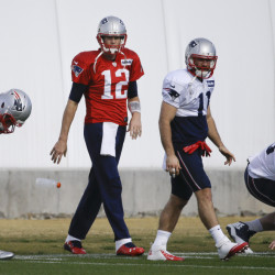 New England Patriots quarterback Tom Brady (12) warms up with teammates, including wide receiver Julian Edelman (11), during practice Wednesday in Tempe, Ariz. The Patriots play the Seattle Seahawks in Super Bowl XLIX Sunday in Glendale, Ariz.