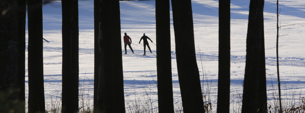 Two women ski on a trail at Harris Farm in Dayton on Thursday, January 29, 2015. More snow forecast for Friday should make winter outdoor enthusiasts happy. (Photo by Gregory Rec/Staff Photographer)