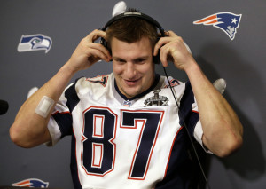 New England Patriots tight end Rob Gronkowski puts on headphones to hear a question during a news conference Thursday in Chandler, Ariz. The Patriots play the Seattle Seahawks in Super Bowl XLIX on Sunday in Phoenix.