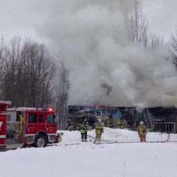 Area firefighters work the scene of a mobile home fire on North Belfast Avenue in Augusta.