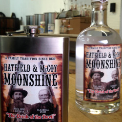 A flask and bottle are shown Jan. 22, 2015, at the Hatfield & McCoy Moonshine distillery in Gilbert, W.Va.