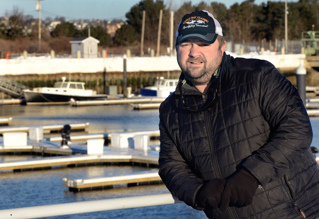 "Capt. Mike Faulkingham is a charter boat captain, seen at his home port at Spring Point Marina in South Portland. He said, ""There isn't a guide here who's not thrilled"" about a mandate to reduce the number of striped bass that can be caught by recreational fishermen.  Photo by John Patriquin/Staff Photographer"