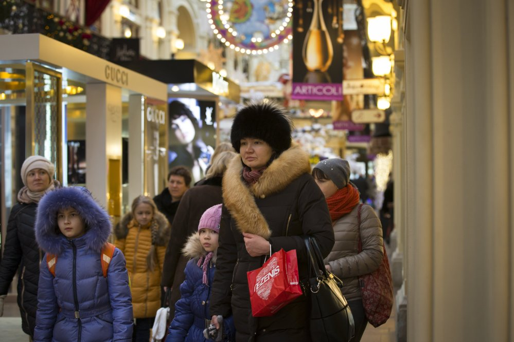 """Only the well-heeled can afford to shop at the GUM department store in Moscow. """"Here, everything changes so often. So I would like stability,"""" shopper Olga Mozalyova said. New Year's Day began a long holiday for most Russians that runs until Jan. 12.  The Associated Press"""