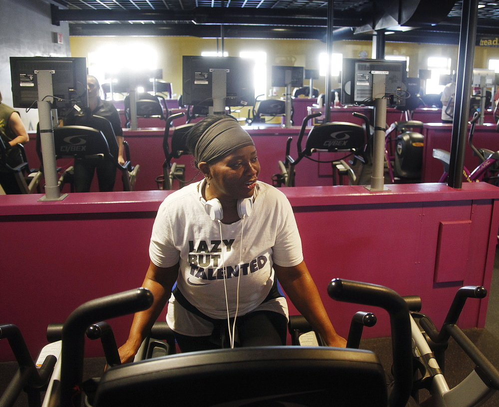 """Cynthia Young of Portland, a survivor of breast cancer, sees herself as an example to others who have struggled with illness. """"I'm here starting 2015 the right way,"""" she said. Jill Brady/Staff Photographer"""
