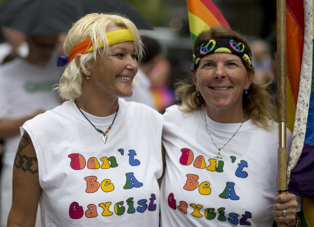 Kimmy Denny and Barb Lawrence of Palm Harbor, Fla., wait outside a gay marriage hearing in Miami last year.  Same-sex couples may soon be able to wed in Florida. The Associated Press