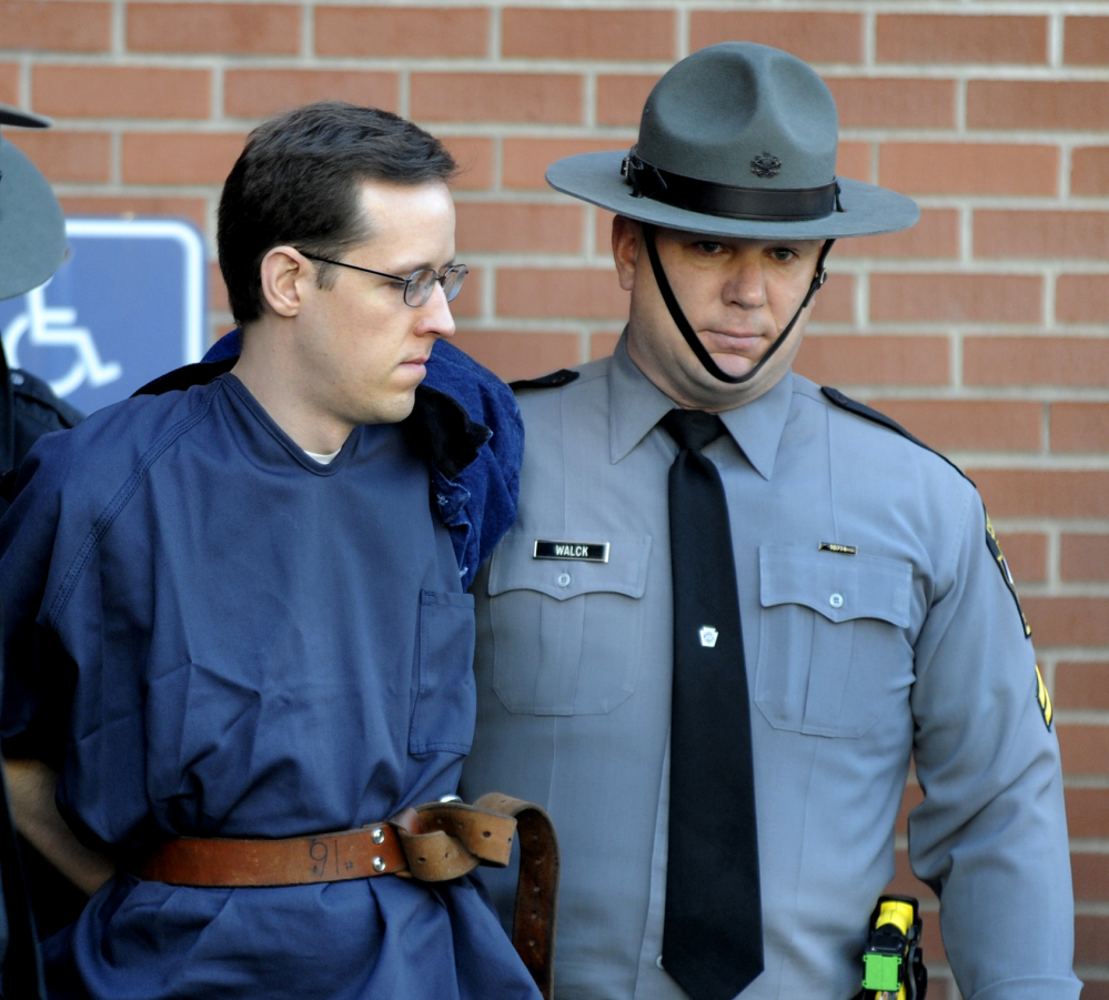 Eric Frein is led from the courthouse after his hearing Monday in Milford, Pa. Frein is charged with fatally shooting one state trooper and wounding another. The Associated Press